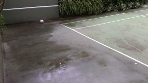 Mouldy tennis court before cleani
